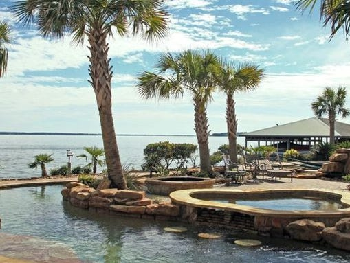 this home on lake livingston has a texas sized pool