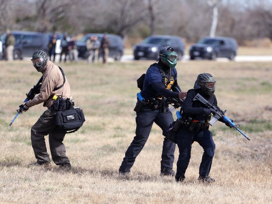 Corpus Christi Police Department cadets Ryan Timm (from left), Michael Love and Ricky Jakobsohn participate in a training exercise that simulated an officer down Wednesday, Jan. 24, 2018, at a training site in Mathis.