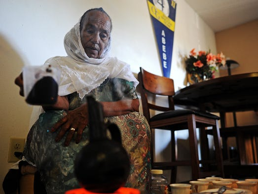 Tibereh Hidru, who lives in Eritrea and is visiting her daughter and son-in-law, makes coffee for a traditional Ethopian coffee ceremony, which is done daily, on Wednesday morning, July 23, 2014, at her daughter and son-in-law's apartment in Sioux Falls, S.D. Hidru had not seen her daughter for 17 years until her trip to Sioux Falls.