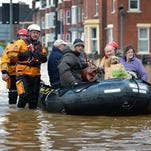 Rescue teams evacuate people from their homes after Storm Desmond caused flooding on December 7, 2015 in Carlisle, northern England.