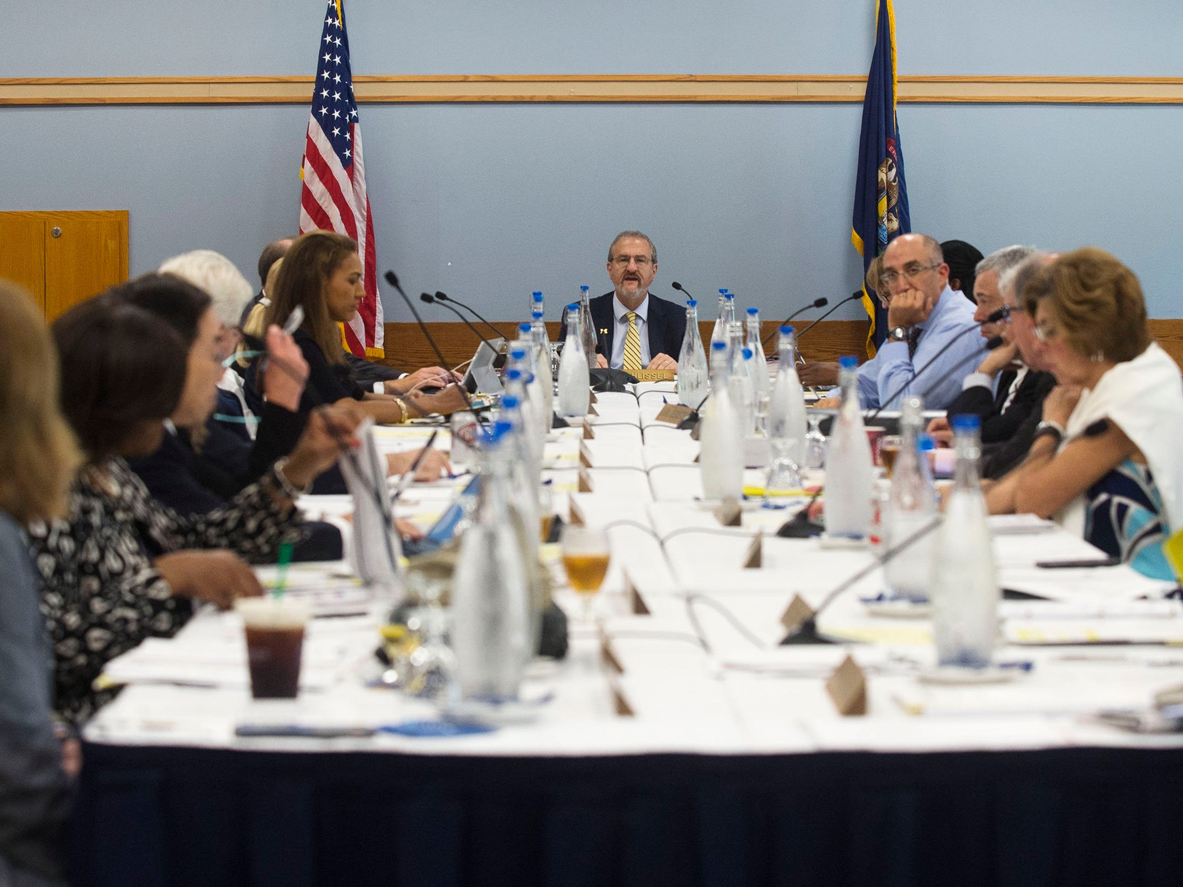 University of Michigan President Mark Schlissel, center, speaks during the Board of Regents meeting on Thursday, June 15, 2017, at the Michigan Union in Ann Arbor. Some U-M students would like to see top university officials spend more from the endowment to support students.
