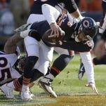 Broncos defensive end Derek Wolfe sacks Bears quarterback Jay Cutler on Sunday in Chicago.