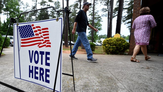 Voters head for the Warren Road Community Center to cast their ballots Tuesday afternoon May 22, 2018 in Augusta, Ga.