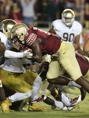 Florida State's Karlos Williams runs for a touchdown
