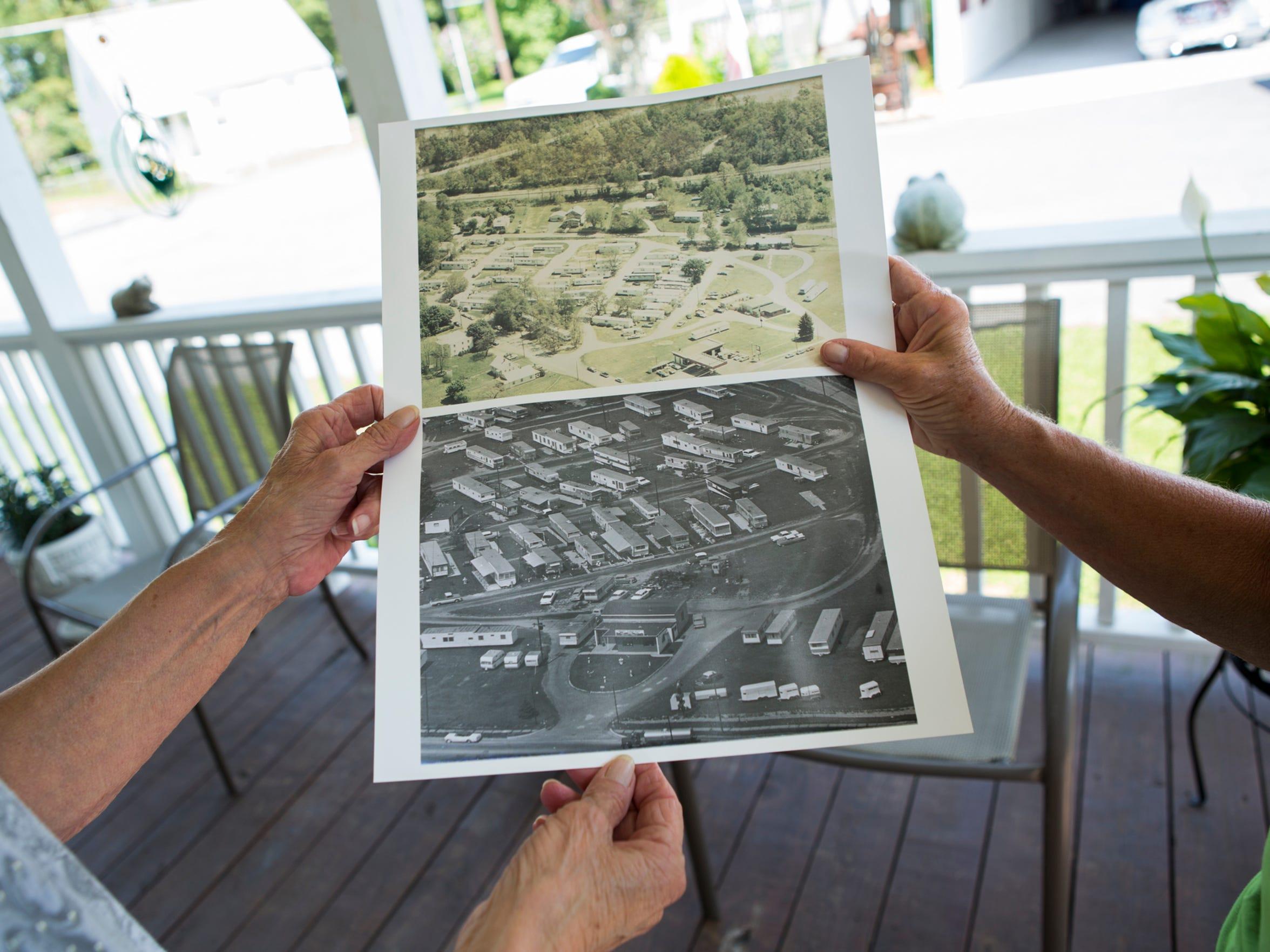Bobbi Shiflett and neighbor look at historical photos