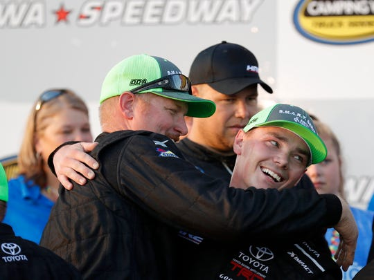 Brett Moffitt, right, celebrates with crew members after winning the M&M's 200.