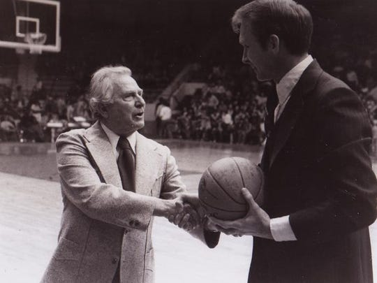 Bobby Paschal, right, honors longtime basketball coach Dutch Reinhardt, who led the program from 1931 to 1957.
