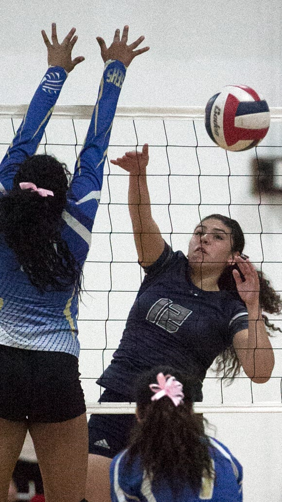 Myranda Manriquez, 12, of Mountain View gets a shot past Lorena Ituarte, 9, of San Elizario on Tuesday night.