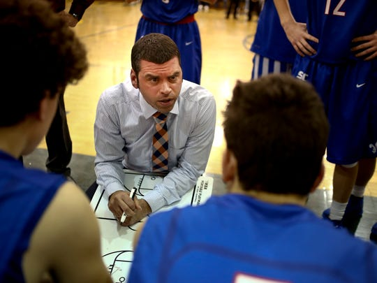 St. Clair coach Shawn Sharrow talks with players. during
