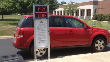 A thermometer shows the interior temperature of a car parked out in the sun, 142 degrees, compared to the 108 degree outdoor reading. Submitted photo