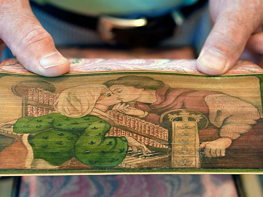 Landmark Booksellers owner Joel Tomlin shows a fore-edge