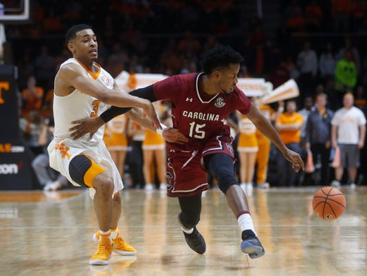 The ball gets away from South Carolina guard Wesley Myers (15) as he is defended by Tennessee guard James Daniel III (3) during the second half of an NCAA college basketball game Tuesday, Feb. 13, 2018, in Knoxville, Tenn. (AP Photo/Crystal LoGiudice)