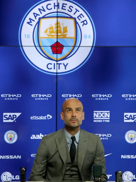 Manchester City new manager Pep Guardiola during a press conference at the City Football Academy in Manchester, England, Friday July 8, 2016. Guardiola faces the media for the first time Friday since being named Manchester City manager, ahead of the new English Premier League soccer season. (Peter Byrne / PA via AP)