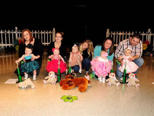 The infants to 11-months-old girls winners are, from left, London Arnold, fourth runner-up; Jordyn Rumfelt, second runner-up; Rylann Welborn, Tiny Princess; Raeleigh Potts, first runner-up; and Gracie Beard, third runner-up. Other winners not pictured are Aubree Richardson, Most Natural; and Max Elizabeth Fansler, People's Choice and Prettiest Dress.