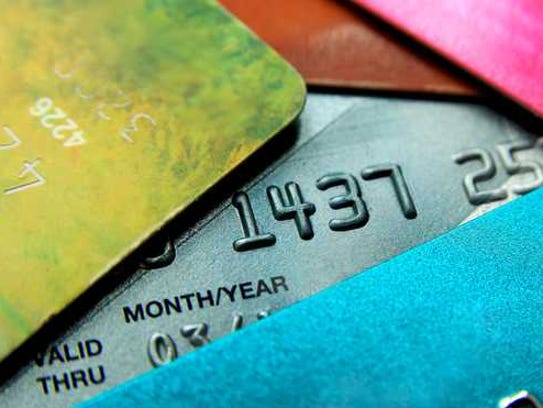 Pile of multicolored credit cards.