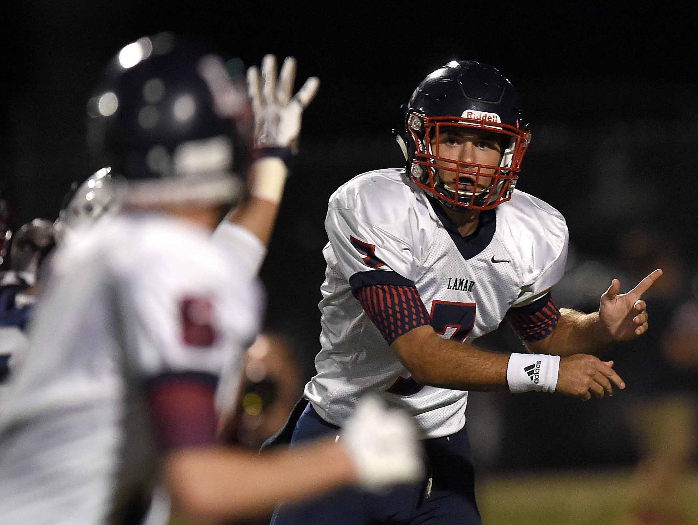 Lamar quarterback Davis Harrison passes to Clay Truelove (5) on Friday, October 30, 2015, at Madison-Ridgeland Academy in Madison, Miss.