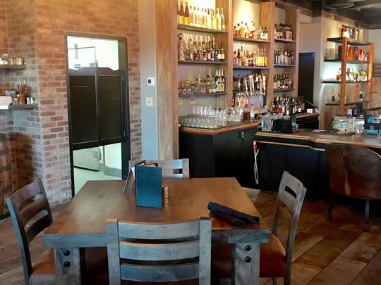 The interior of the new Hard Water House works a neo-Western look with brick, leather, wagon wheel fixtures and reclaimed wood.