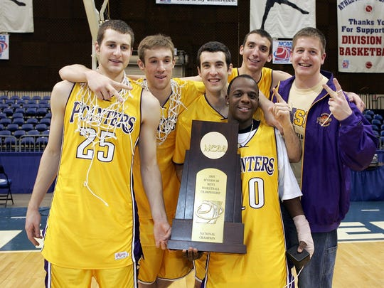The Pointers hold their national championship trophy after the team's 2005 season.