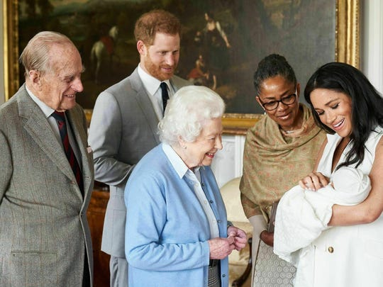 Britain's Prince Harry and Meghan, Duchess of Sussex, joined by her mother, Doria Ragland, show their new son to Queen Elizabeth II and Prince Philip at Windsor Castle, Windsor, England. Prince Harry and Meghan have named their son Archie Harrison Mountbatten-Windsor.