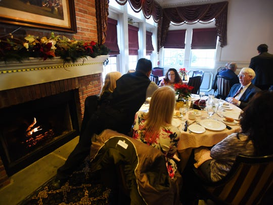 Guests savor the fireplace and lunch at The Brick House