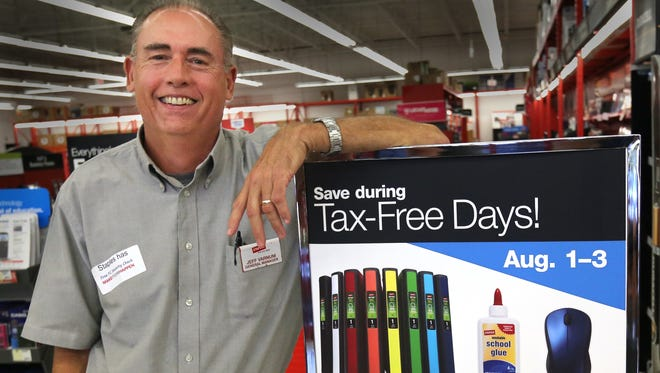 Staples store manager Jeffrey Varum was busy on Wednesday, July 29, 2014 getting his store ready for Friday's big tax free holiday for school shoppers.