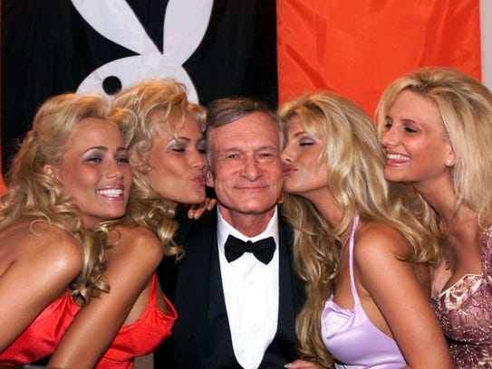 Playboy founder and editor-in-chief Hugh Hefner receives