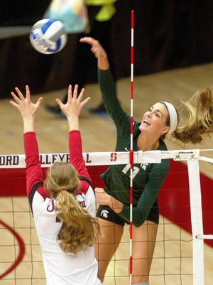 South Lyon resident Chloe Reinig uncorks a kill shot for Michigan State during last year's NCAA tournament against host Stanford University at Maples Pavilion.