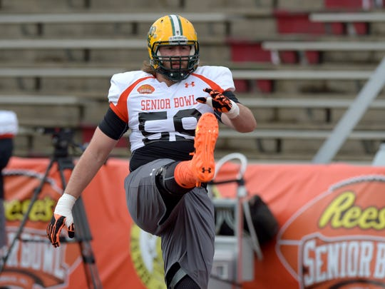 North squad offensive tackle Joe Haeg of North Dakota State (59) stretches before the start of Senior Bowl practice at Ladd-Peebles Stadium.