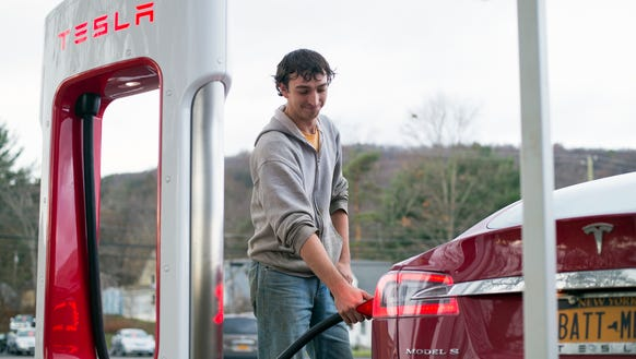 James Mead, 30, of Owego, charges his Model S Tesla