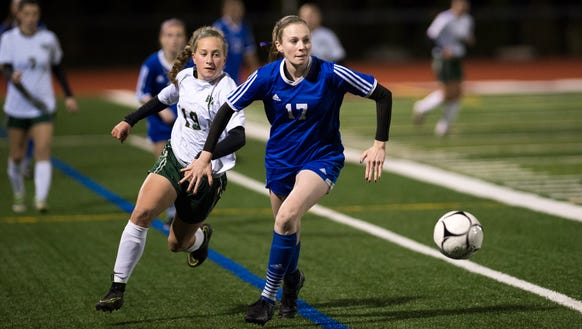 Pearl River's Meghan Woods (17) fights for possession