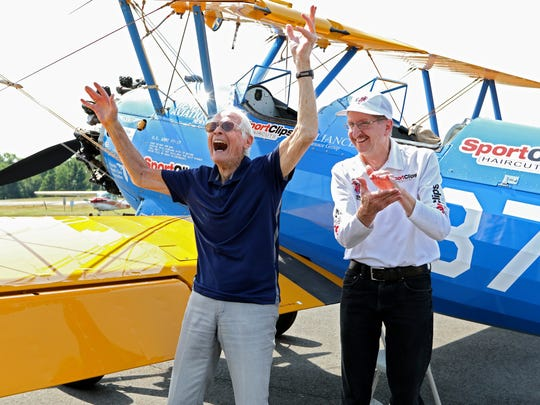 WWII veteran Arthur Hershkowitz, 92, celebrates after taking a short flight in a 1942 Stearman, piloted by Mike Winterboer, with Ageless Aviation Dreams Foundation after taking a short flight on a 1942 Stearman. Seniors from the Spring Hills Senior Assisted Living Facility had the opportunity to fly in a 1940's Boeing Stearman, open cockpit biplane.  The event was sponsored by the Ageless Aviation Dreams Foundation and the event was held at the Central Jersey Regional Airport in Hillsborough Sunday.