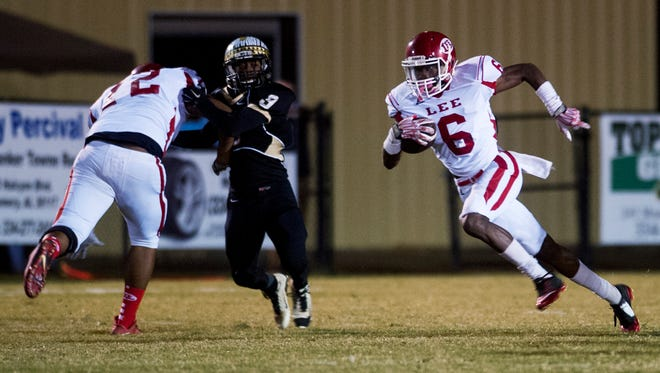 Lee's Henry Ruggs (6) carries against Wetumpka at Hohenberg Field in Wetumpka, Ala. on Friday October 30, 2015. (Mickey Welsh / Montgomery Advertiser)