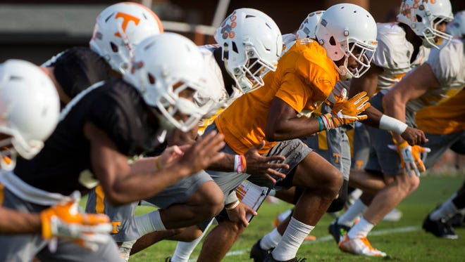 Players warm-up during a University of Tennessee football practice at UT on Tuesday, Oct. 25, 2016.