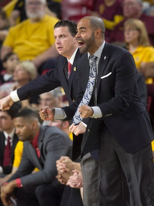 ASU assistant coaches Stan Johnson (front right) and Barret Peery coach during the first half of the PAC-12 college basketball game against Colorado at Wells Fargo Arena in Tempe on Saturday, January 17, 2015.