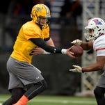 North squad quarterback Carson Wentz of North Dakota State (11) hands off to running back Kenneth Dixon of Louisiana Tech (28) during Senior Bowl practice at Ladd-Peebles Stadium.