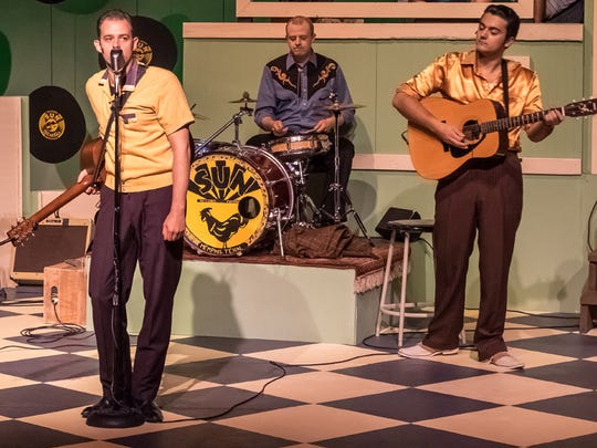 "Todd Meredtih as Johny Cash sings in front of Morgan McDowell as Elvis Presley in Old Creamery Theatre's production of ""Million Dollar Quartet."" Photo by Lily Allen-Duenes."