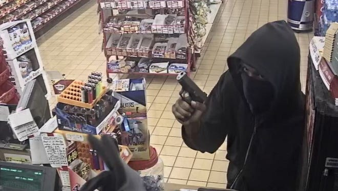 Surveillance cameras at the Kwik Sak on Lowry Street in Smyrna captured images of a Sunday night robbery.