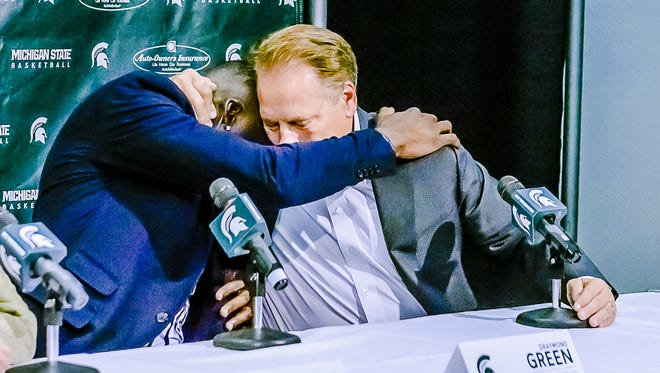 Former MSU basketball player Draymond Green, left, hugs MSU men's basketball coach Tom Izzo during a press confrence announcing Green's $3.1 million donation to MSU athletics.