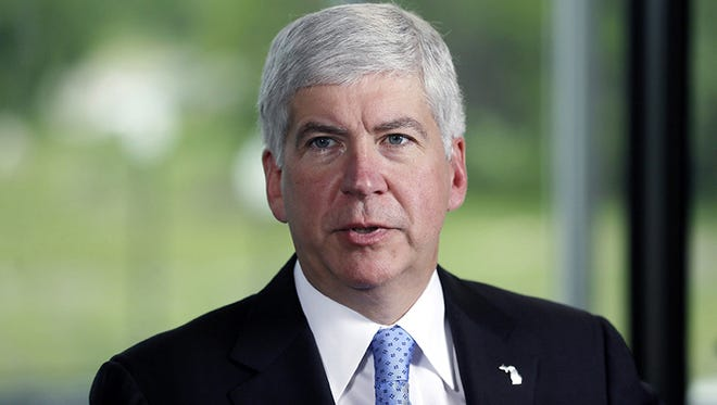 In this June 20, 2014 file photo, Michigan Republican Gov. Rick Snyder speaks during an interview before signing legislation to provide state funding for Detroit municipal pensions, in Detroit. (AP Photo/Carlos Osorio)