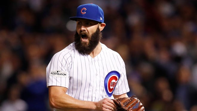 Jake Arrieta went 14-10 last season with the Cubs.