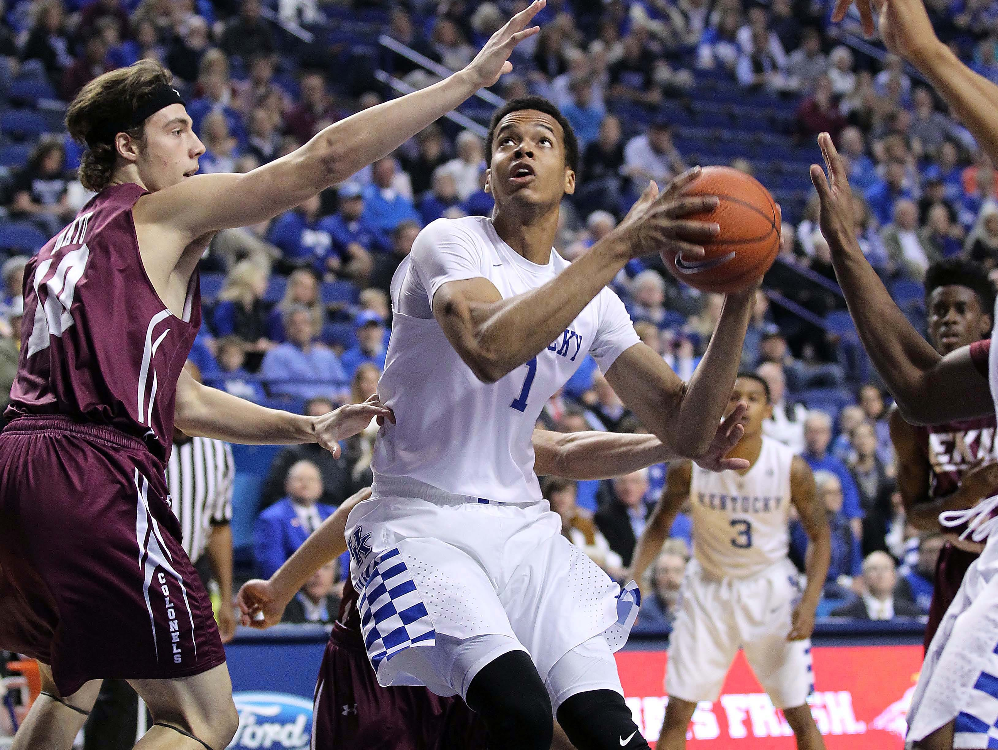 Dec 9, 2015; Lexington, KY, USA; Kentucky Wildcats forward Skal Labissiere (1) shoots the ball against Eastern Kentucky Colonels forward Nick Mayo (10) in the first half at Rupp Arena.