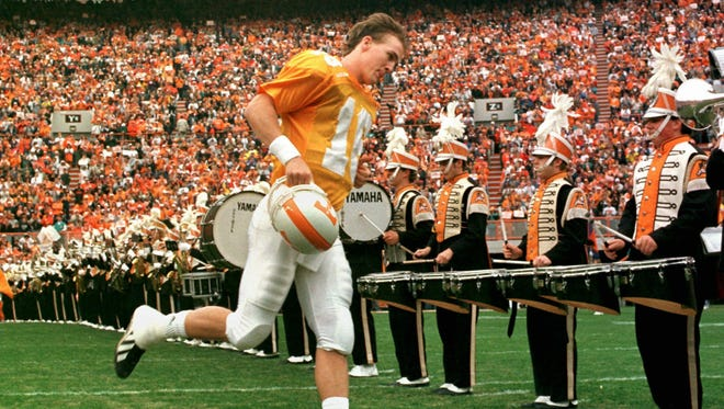 Tennessee quarterback Peyton Manning takes the field for his last home game on Saturday, Nov. 29, 1997 in Knoxville, Tenn. Tennessee defeated Vanderbilt 17-10. (AP Photo/Mark Humphrey)