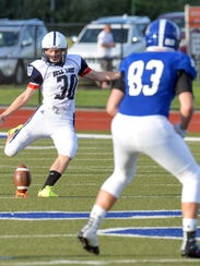 Gull Lake's Mike Tracy kicks off during the home opener