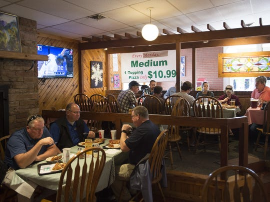 The lunch crowd fills the dining room at Panhandler's Pizza on W. Elizabeth Street on Wednesday, July 26, 2017. Owner John Olson has announced that he will not continue operating the business in another location after Panhandler's serves its last slice on Elizabeth Street on September 24.