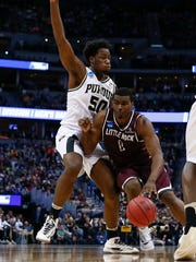 Mar 17, 2016; Denver , CO, USA; Arkansas Little Rock Trojans forward Roger Woods (0) drives to the lane with Purdue Boilermakers forward Caleb Swanigan (50) defending during the second half of Purdue vs Arkansas Little Rock in the first round of the 2016 NCAA Tournament at Pepsi Center. Mandatory Credit: Isaiah J. Downing-USA TODAY Sports