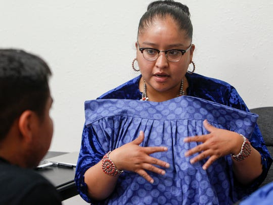 Miss Navajo Nation Crystal Littleben talks with program instructor Wilfred Jumbo on Sunday during a skirt-making workshop hosted by the Office of Miss Navajo Nation and the Navajo Cultural Arts Program at Diné College's north campus in Shiprock.