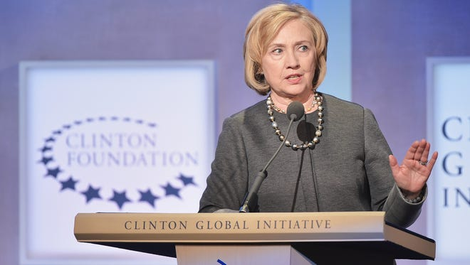 Former US Secretary of State Hillary Clinton  addresses the audience during the Opening Plenary Session: Reimagining Impact for the Clinton Global Initiative on September 22, 2014 at the Sheraton New York Hotel & Towers in New York City.