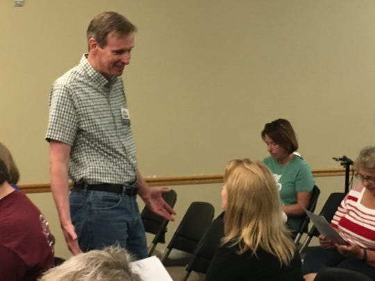 Mike McCabe, a Democratic gubernatorial candidate, speaks with a forum attendee before Saturday's candidate forum at the Kress Family Branch of the Brown County Library in De Pere.