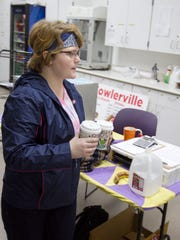 Fowlerville senior Zella Patrick heads out to deliver coffee to classroom teachers as Brewed Awakening's short daily half-hour of operation comes to a close.