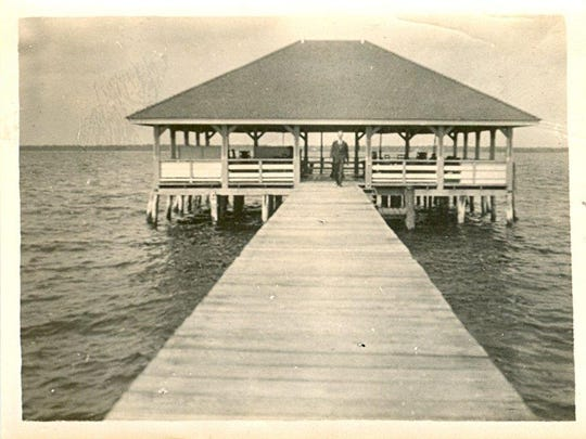Edisons' pier and pier pavilion, with unidentified man at entrance, circa 1915